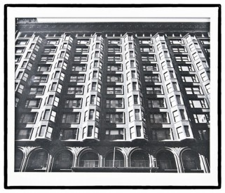 original undated richard nickel silver gelatin photograph or print depicting the facade of adler and sullivan's chicago stock exchange building	– hand-signed on the verso with name and address