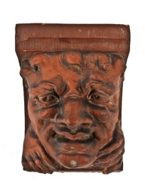 """19th century ornamental red slip glaze terra cotta exterior grotesque corbel from the """"lake front"""" train depot– possibly american or northwestern terra cotta company, chicago, il."""