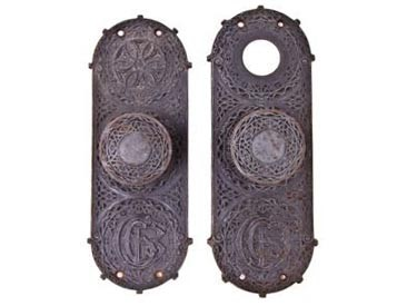 late 19th century cast iron chicago stock exchange building doorknobs with monogrammed backplates
